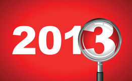 Bringing in 2013. 2013 with a magnifying glass Royalty Free Stock Photo