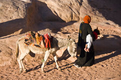 Bringing the baby home, Jordan. A mother is bringing her baby home in the archaeological site of Petra, Jordan Stock Photography