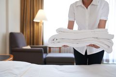 Bringing fresh towels Royalty Free Stock Photography