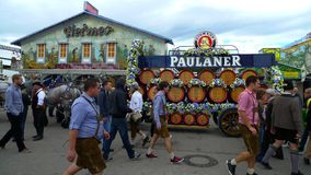 Bringing in the kegs at Oktoberfest. Over the course of Oktoberfest, 3 million liters of beer are Stock Photos
