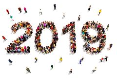 Bringing in the new year. Large group of people forming the shape of 2019 celebrating a new year concept on a white background. Royalty Free Stock Photography