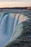 Brink of Niagara Falls. A view of the brink of Niagara Falls (Horseshoe Falls) taken at dawn from the Canadian side Stock Photos