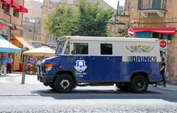 Brinks armored Truck. The Brinks company  provides security services to banks, retailers and government institutions.Brinks armored trucks transport money and Royalty Free Stock Photography