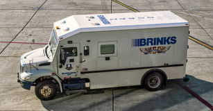 Brinks security truck. The Brinks company provides security services to banks, retailers and government institutions.Brinks armored trucks transport money and Royalty Free Stock Photos