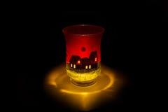 Brinna stearinljus i behå royaltyfri foto