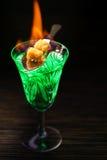 Brinnande absint på mörk tabellbakgrund Royaltyfria Foton