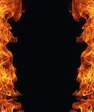 Brinnande brandflamma på svart bakgrund Royaltyfria Bilder