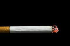 Brinnande cigarett Arkivfoton