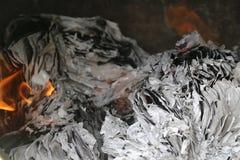 Brinnande skrivbordsarbete, förstörande tecken Royaltyfri Bild