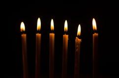 Brinnande stearinljus Arkivbild