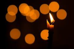 Brinnande stearinljus Arkivfoto
