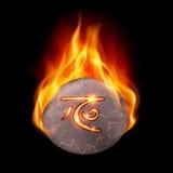 Brinnande sten med den magiska runan Royaltyfria Foton