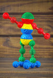 Brinque o robô feito dos detalhes coloridos plásticos do brinquedo Fotos de Stock