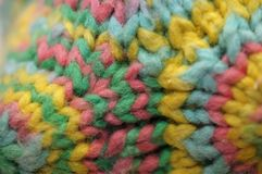 Brinquedo colorido feito malha do desenhista de matéria têxtil do polígono do fio imagem de stock
