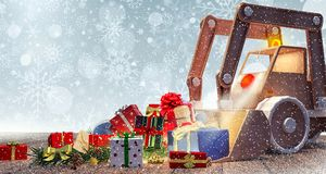 Brinquedo da máquina escavadora com presentes de Natal imagem de stock royalty free