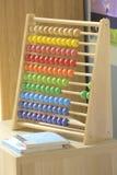 Brinquedo de madeira colorido do ábaco fotografia de stock royalty free