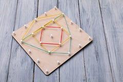 Brinquedo de madeira da lógica Brinquedos da faculdade criadora O conceito do pensamento lógico fotografia de stock royalty free