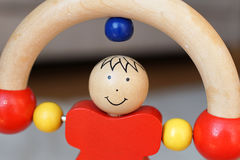 Brinquedo de madeira do bebê - homem do rolamento Fotos de Stock Royalty Free