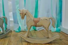 Brinquedo de madeira do cavalo em um partido Imagem de Stock Royalty Free