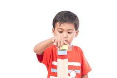 Brinquedo de madeira do jogo bonito do menino Foto de Stock