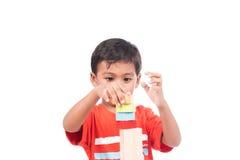 Brinquedo de madeira do jogo bonito do menino Fotos de Stock Royalty Free