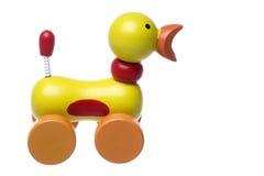 Brinquedo de madeira do pato do rolamento isolado Imagem de Stock