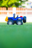 Brinquedo do carro no campo da grama verde Fotos de Stock Royalty Free
