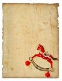 Brinquedo do cavalo de balanço do estilo do vintage da decoração do Natal com p envelhecido Imagem de Stock