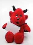 Brinquedo do diabo com uma nota em branco imagem de stock