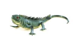Brinquedo do lagarto da iguana no branco Fotografia de Stock