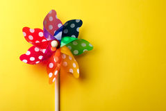 Brinquedo do moinho de vento isolado no fundo amarelo Imagem de Stock Royalty Free