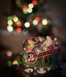 Brinquedo do Natal no fundo de luzes borradas Fotografia de Stock