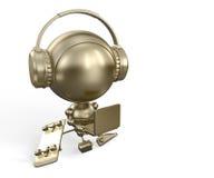 Brinquedo do robô do ouro com caderno & auscultadores Imagens de Stock