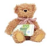 Brinquedo do urso com dinheiro Fotografia de Stock Royalty Free