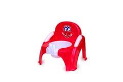Brinquedo plástico da cadeira de urinol fotografia de stock royalty free