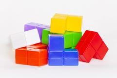 Brinquedos brilhantes coloridos a jogar com sua criança Foto de Stock Royalty Free