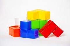 Brinquedos brilhantes coloridos a jogar com sua criança Imagem de Stock