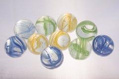 Brinquedos coloridos dos mármores fotografia de stock