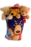 Brinquedos Cuddly em um saco do Natal Fotos de Stock Royalty Free