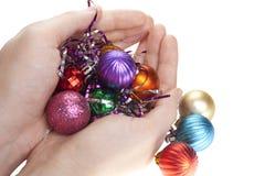 Brinquedos da mão e do Natal Fotografia de Stock