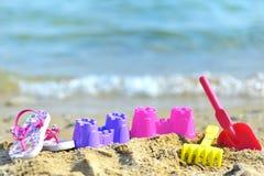 Brinquedos da praia das crianças Fotos de Stock