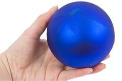 Brinquedos de ano novo em uma mão Imagem de Stock