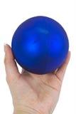 Brinquedos de ano novo em uma mão Imagem de Stock Royalty Free