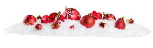 Brinquedos do Natal na neve no branco Fotos de Stock