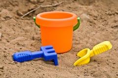 Brinquedos na areia Fotografia de Stock