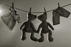 Brinquedos na linha de roupa Imagem de Stock