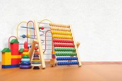 Brinquedos no assoalho Foto de Stock Royalty Free