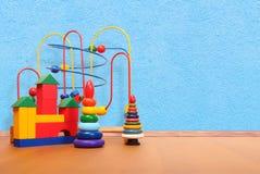 Brinquedos no assoalho Fotos de Stock Royalty Free