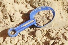 Brinquedos plásticos em um Sandpit Imagens de Stock Royalty Free