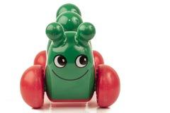Brinquedos verdes da lagarta a jogar com Imagem de Stock